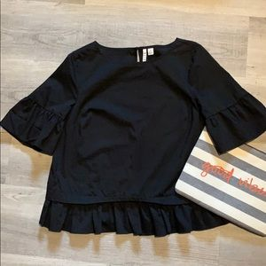 Elle black bell sleeve with ruffle hem blouse.